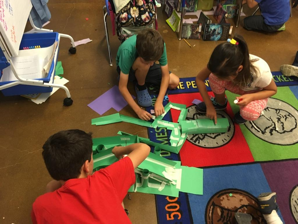 Third graders practice coding by programming and designing a maze.