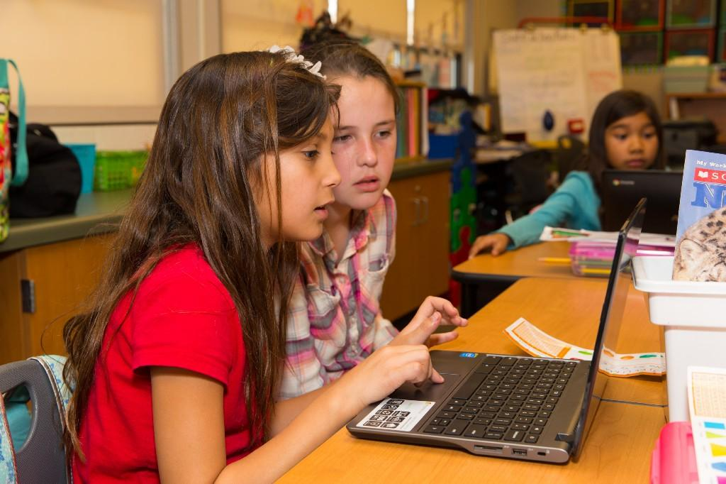 Girls working on laptop