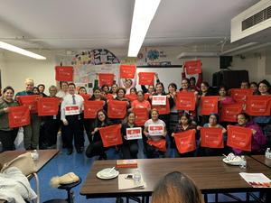 parents and jeff admin holding up totes with the American Heart Association logo