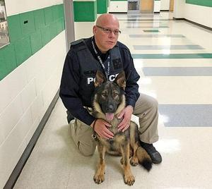 Nico, CMS firearms detection K-9, and his handler, Detective Tim Jolly
