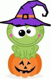 Green frog wearing a purple hat sitting on an orange jack-o-lantern