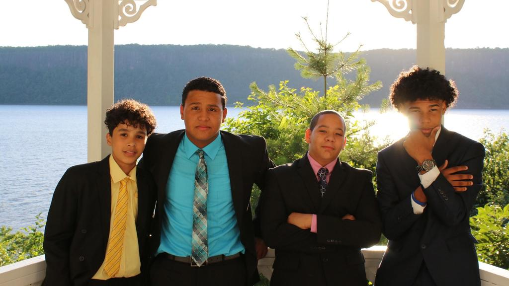 4 boys posing