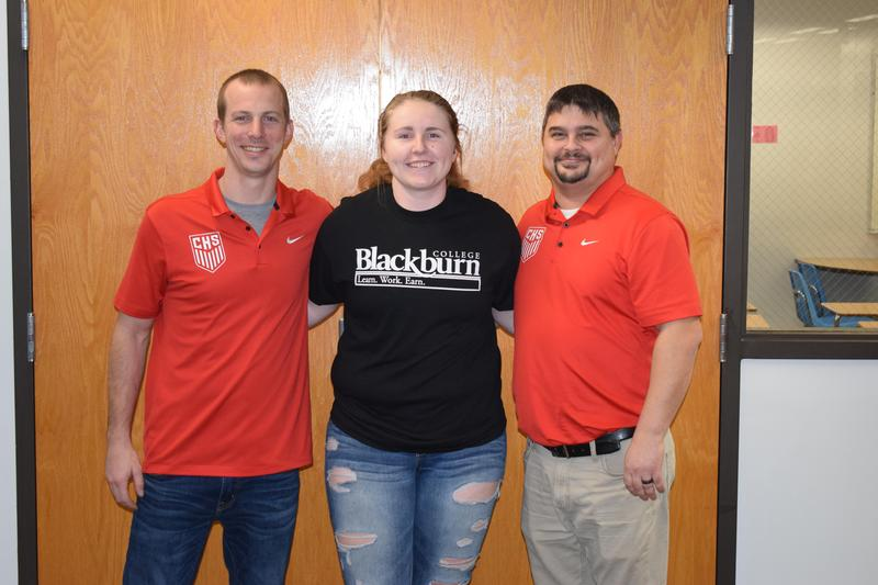 Kassidie Hatlen pictured with her soccer coaches, Tim Johnson and Jason Crowell