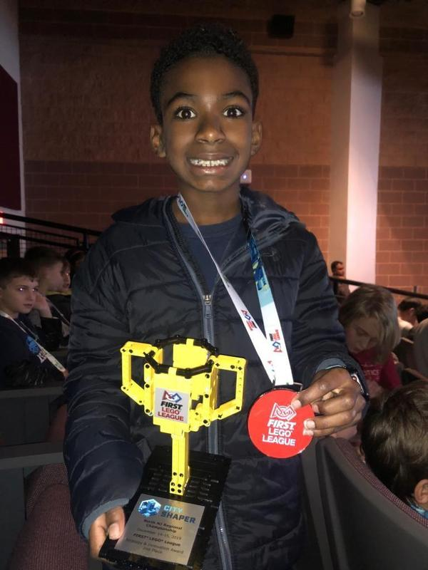 "Jefferson 5th grader Wilson Wright, a member of Jefferson School's Team Legorio robotics team, displays 2nd place trophy awarded to the team for ""Strategy and Innovation"" at the state championship of the First Lego League robotics competition on Dec. 14-15."