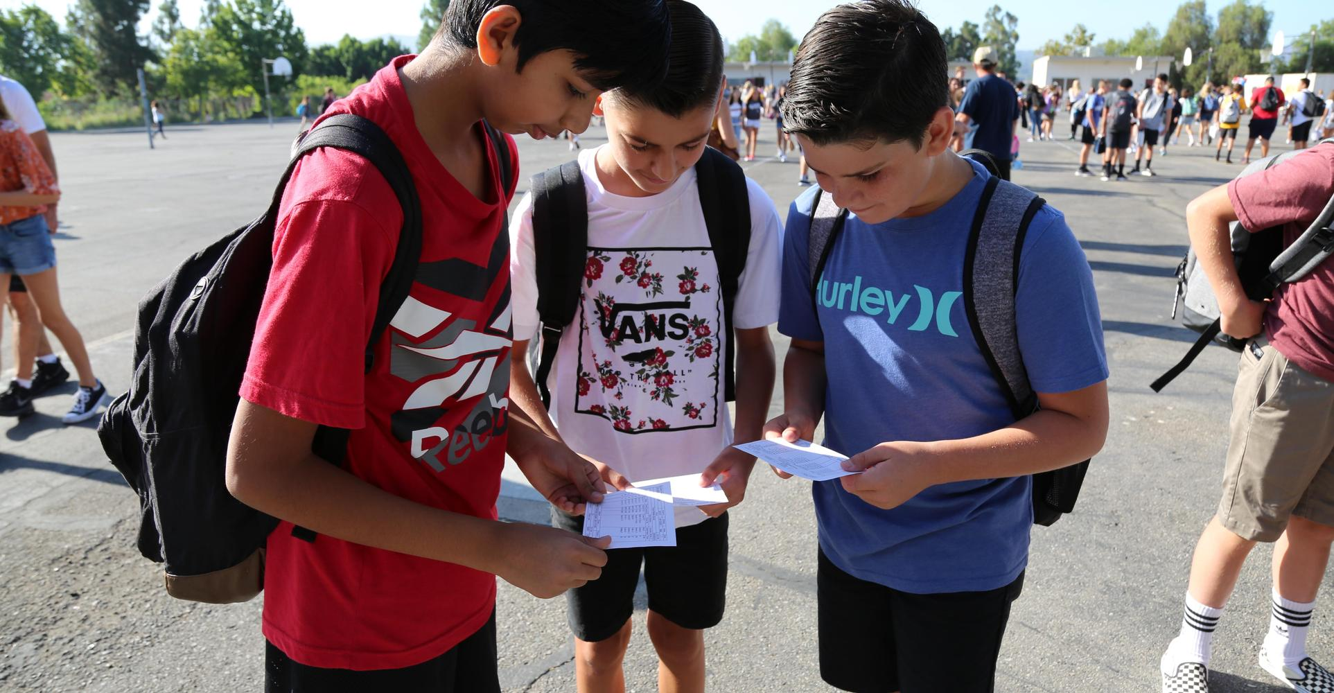 Students share their schedules on the 1st day.