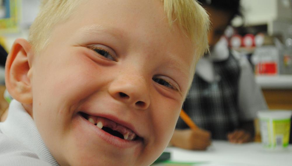 Young boy big smile.