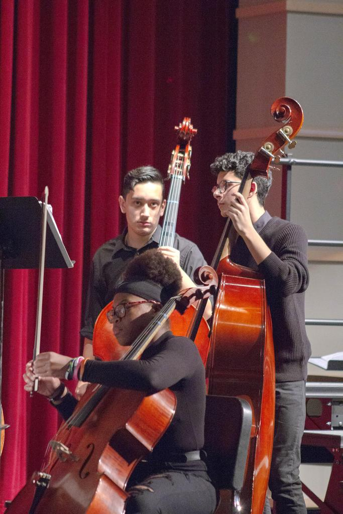 Three cello players