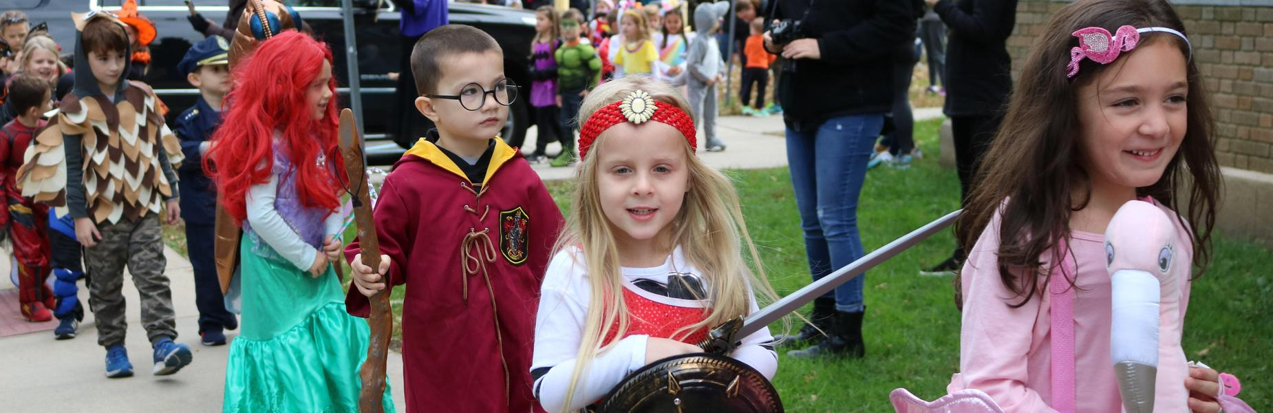 Lincoln School preschoolers and kindergartners show off their costumes in the school's annual Halloween Parade.