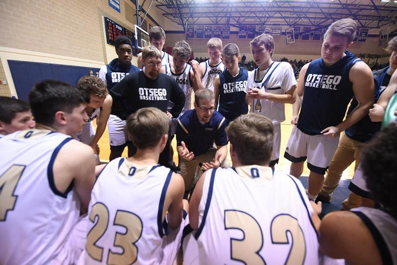 Coach Dennis talks to the team during a time out