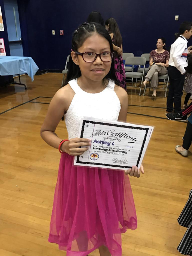 Ashley showing off her certificate