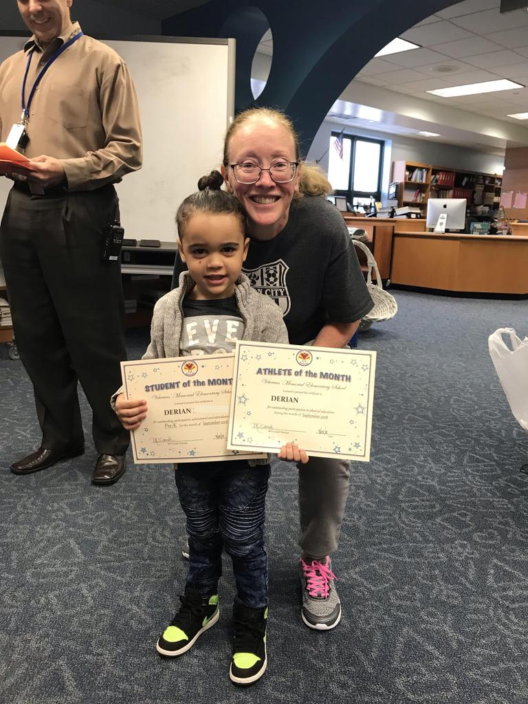 student of the month prek & art derian with principal O'connel
