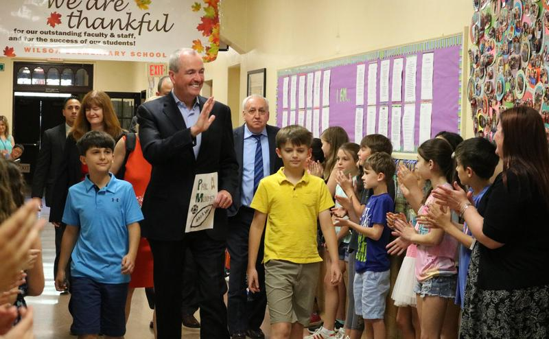 NJ Governor Phil Murphy waves to Wilson School students and staff gathered in the hallways.