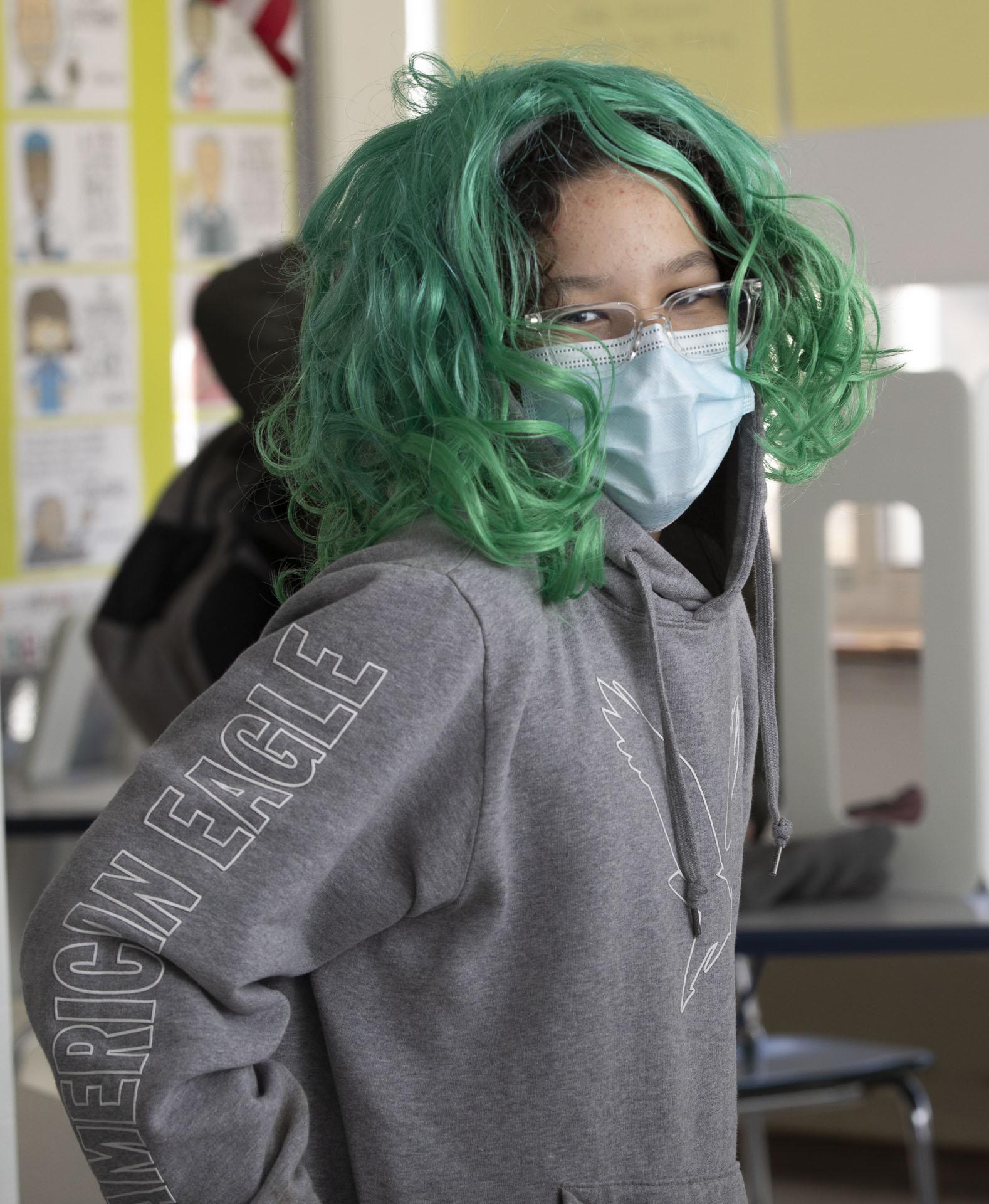 Boy wearing a green wig