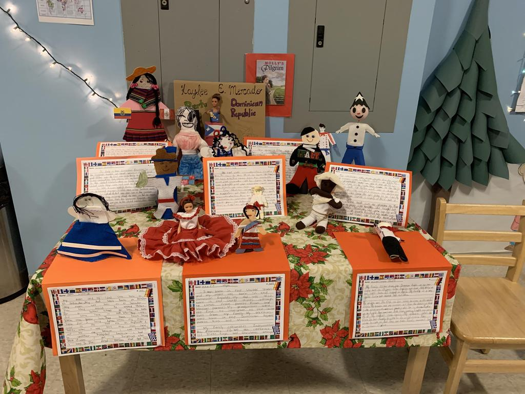 student writing about different cultural dolls