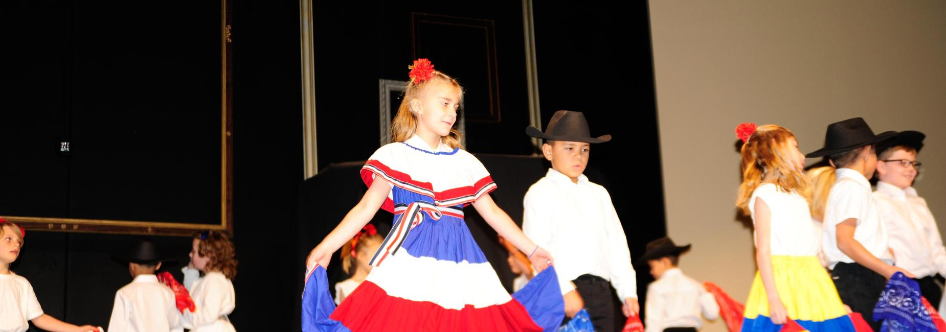 Children dancing in traditional dress