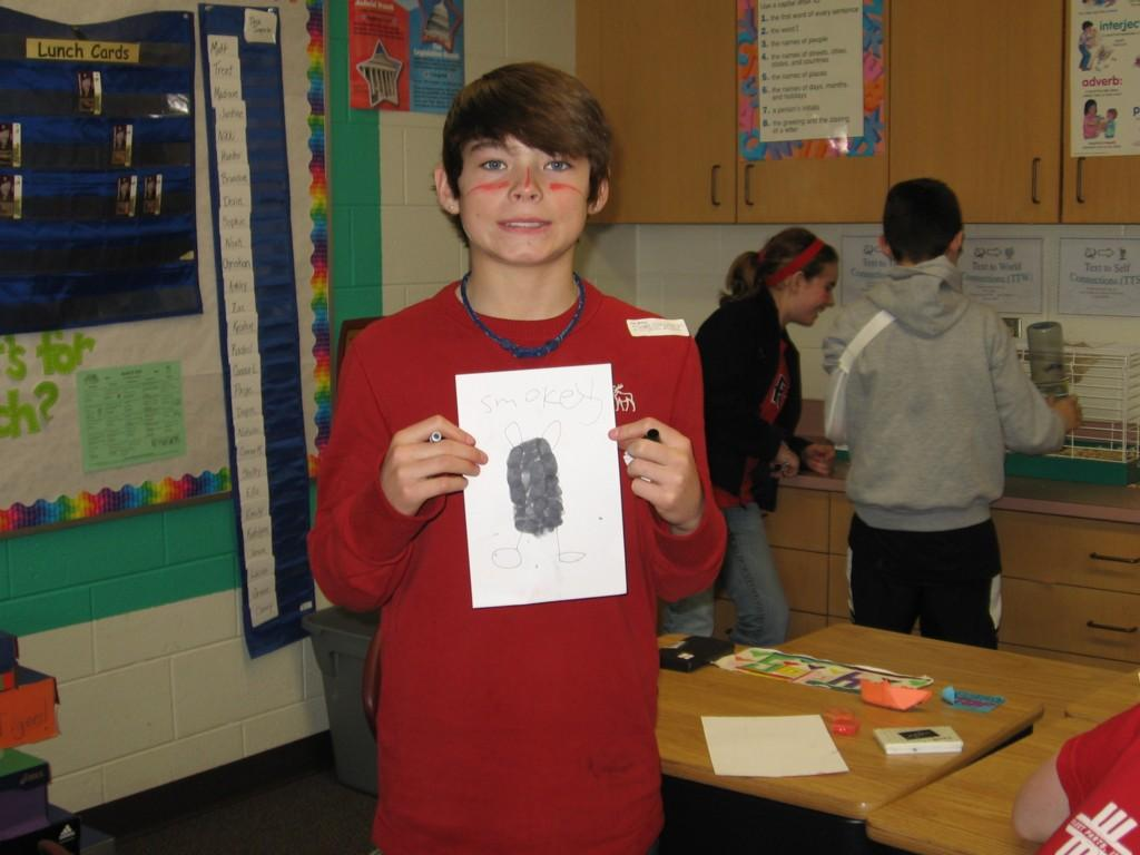 student shows off his artwork named Smokey