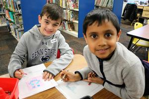 Two Tamaques students design and create characters and a game board for a video game during an afterschool STEAM class.