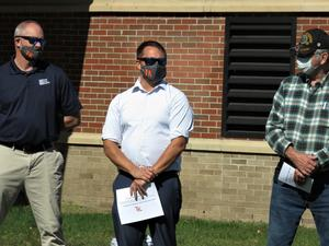 Cade Dammen, (middle) is an OAK director of field operations and also  a TK graduate.