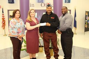 Pictured from left to right are B-L Middle School Principal Sharah Clark, Panther Pantry Founder and B-L Middle School teacher Tristin Padgett, VFW Post 6561 Commander Clenton Gilliam and B-L Middle School Resource Officer Charles Holloway.  VFW Post 6561 provided a $1,000 grant to BLMS early in January to fund the purchase of additional supplies for the school's Panther Pantry.