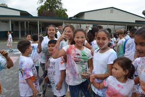 A picture of students colored in color after the Color Run.