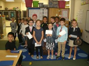 Second graders are dressed and prepared to present information to first graders on Government Day.