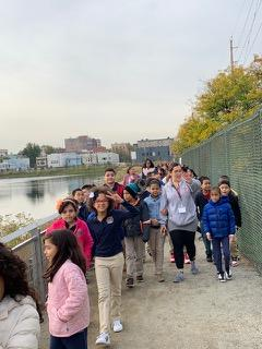 Mrs. Hurtado and a group of students walking on the viaduct pathway