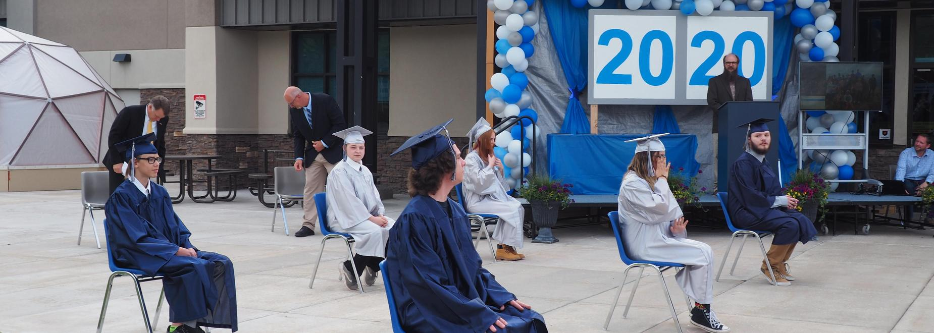2020 grads sitting in chairs