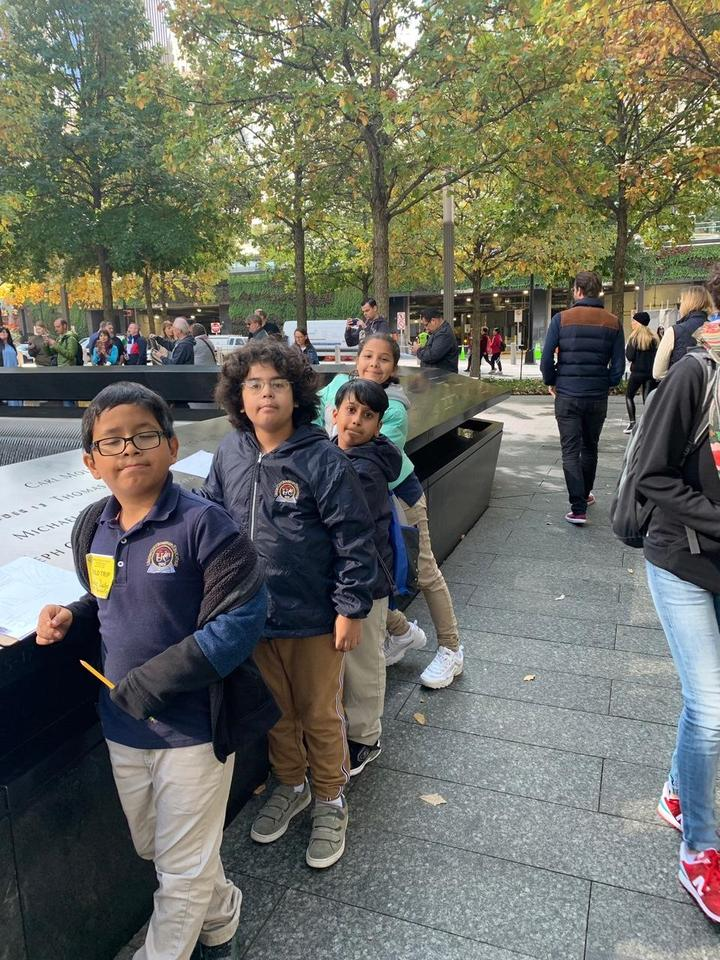 kids standing at one of the memorial walls
