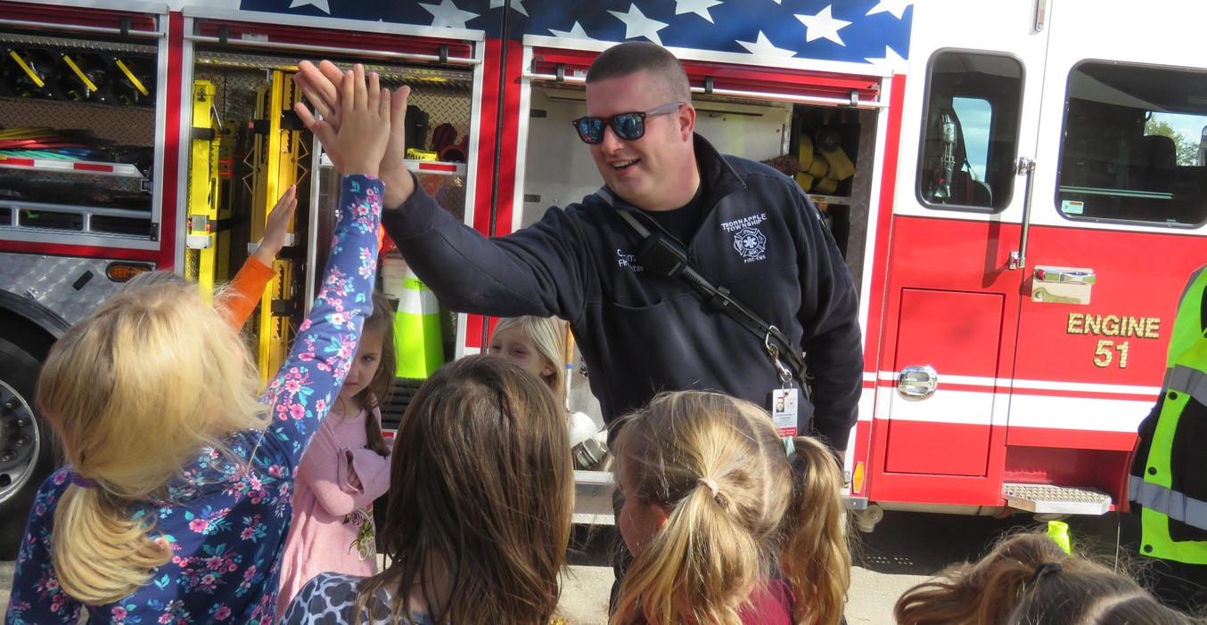 Firefighters teach students about fire safety.