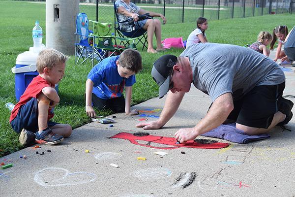 NW families enjoy Sidewalk Art Fair Thumbnail Image