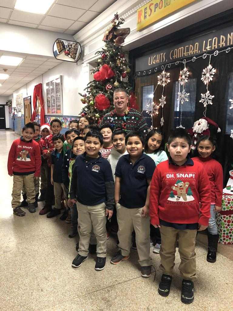 Principal Rivera with the boys and girls wearing Ugly Christmas Sweaters