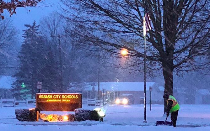 picture of snow falling in front of school