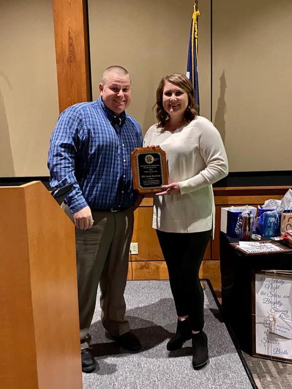 Officer Harrelson receiving her award