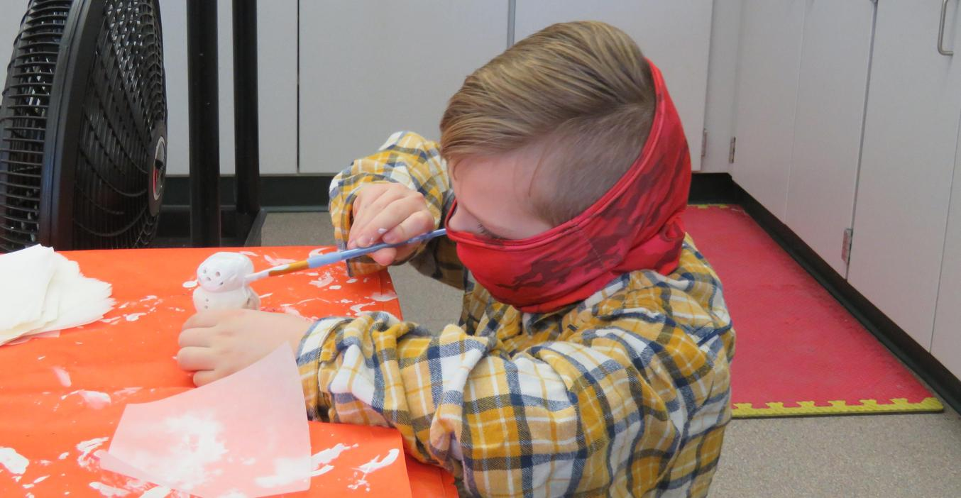 Lee students paint and finish their snowman clay art projects.