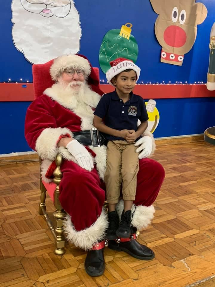 santa with little boy sitting on his lap