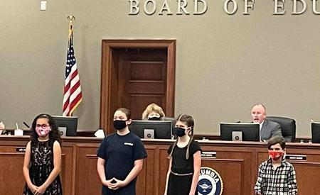 5th Grade 4-H presidents led the Pledge of Allegiance of Tuesday's Board Meeting.