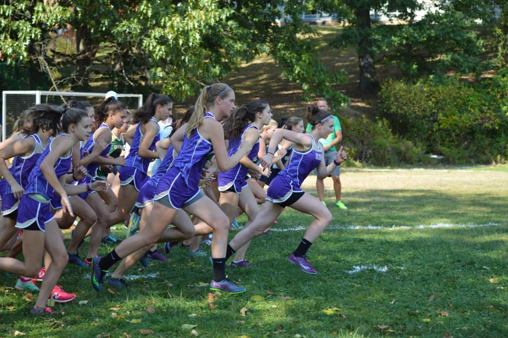 The girls cross country team starts a race.