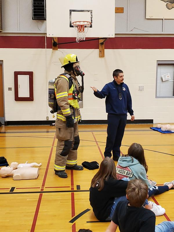 Firefighters discussing cpr