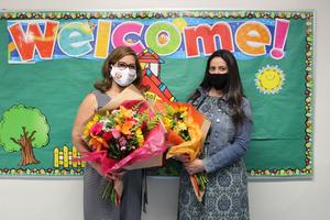 Ms. Romero and Ms. Tambone holding flower bouquets