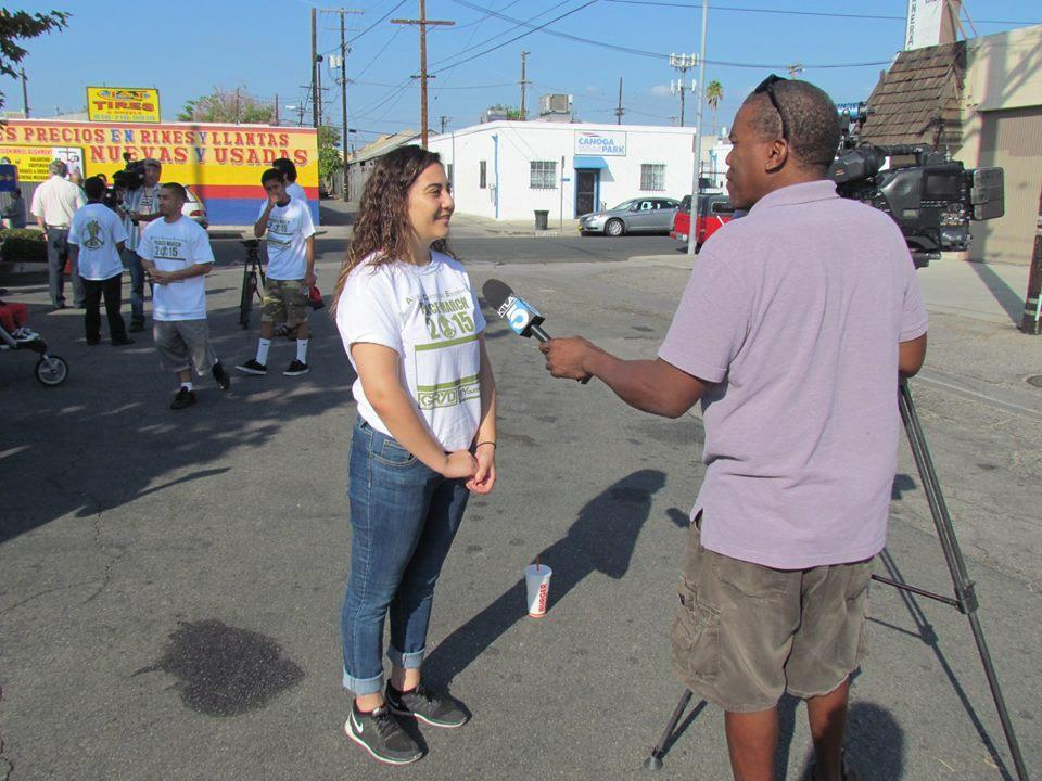student speaks to reporter at Peace March
