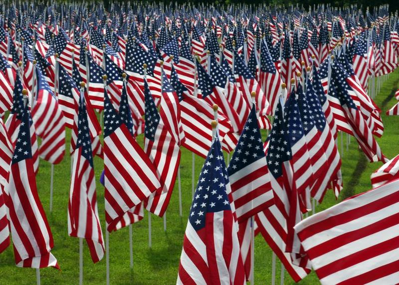 A magnificent display of American flags with each flag representing the life of a hero.