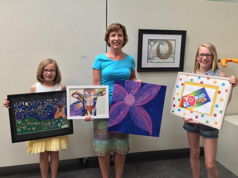 Students with art teacher