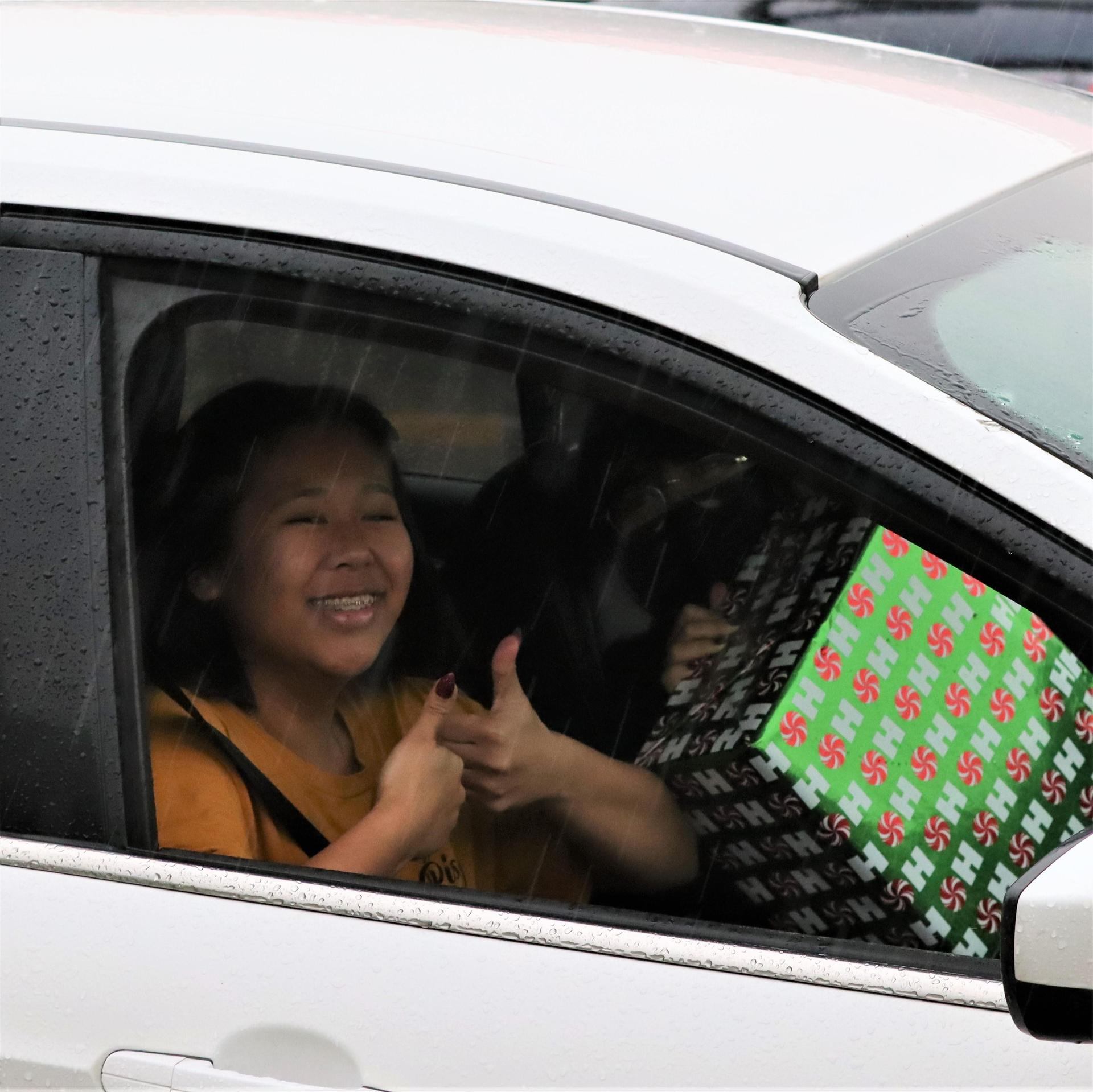 student picking up winter wishes gift