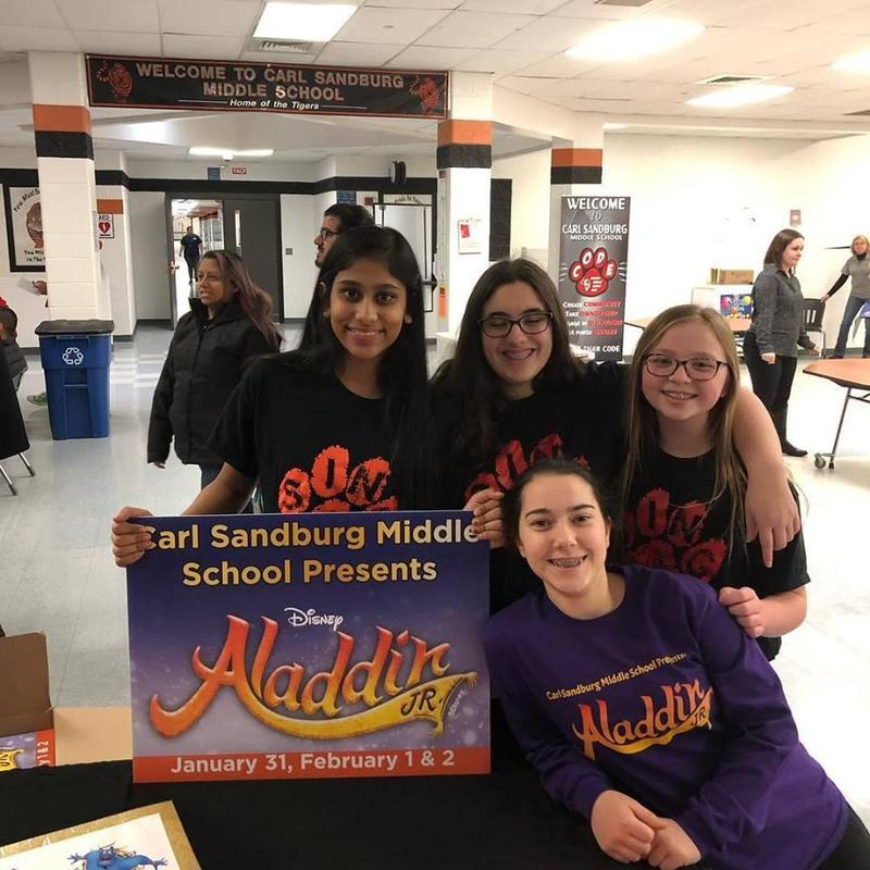 Students with Aladdin Sign