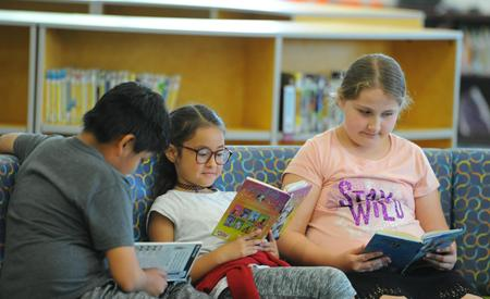 Photo of students reading in GTE Learning Commons