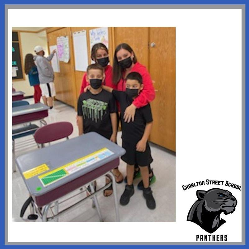 A family at Charlton Street School open house