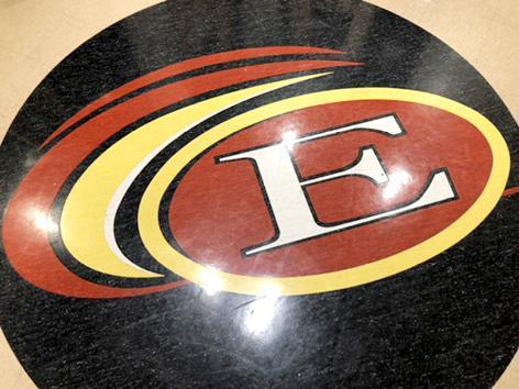 A floor decal inside with the school's circular logo with an