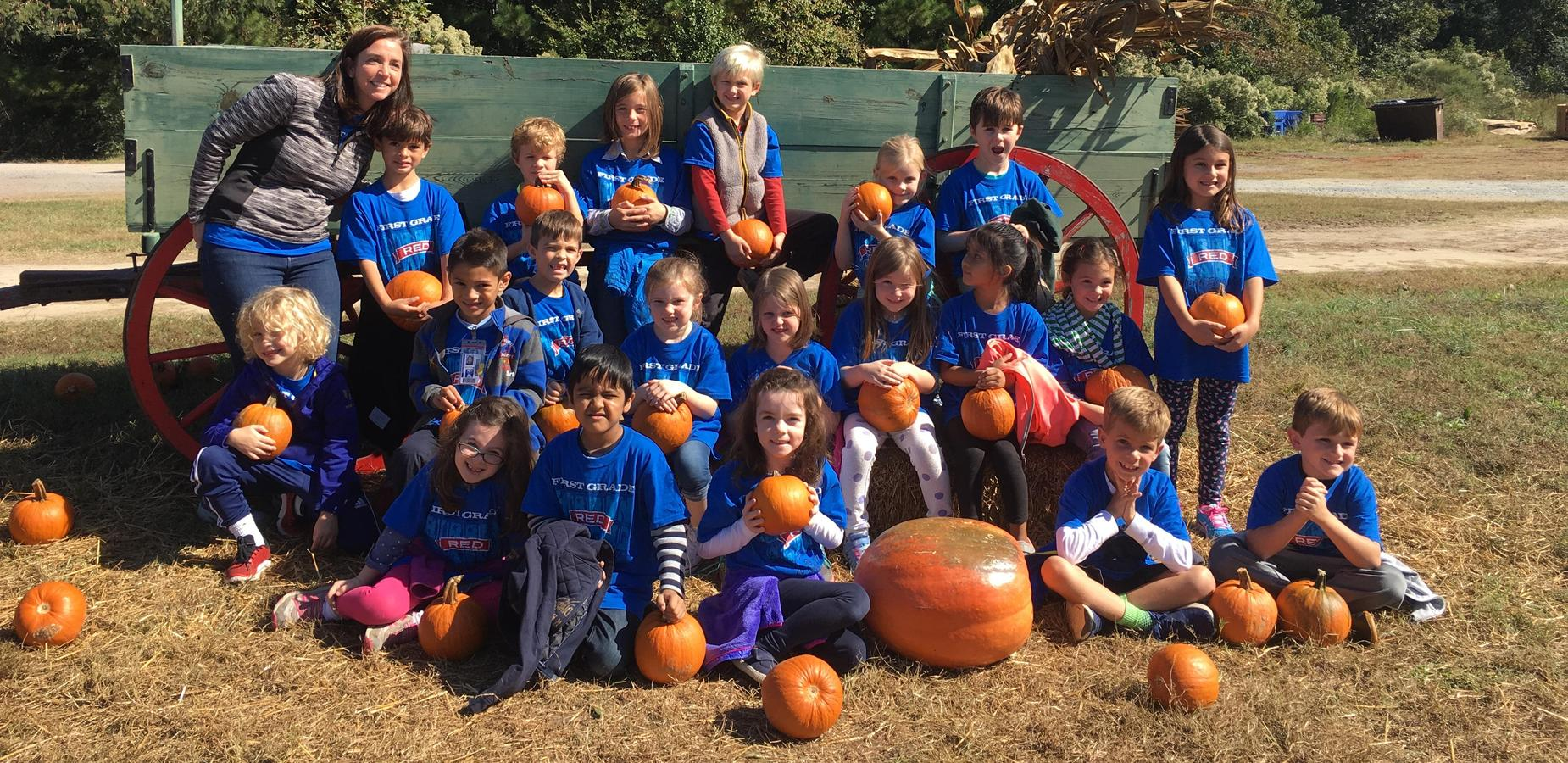 Students with pumpkins on farm field trip