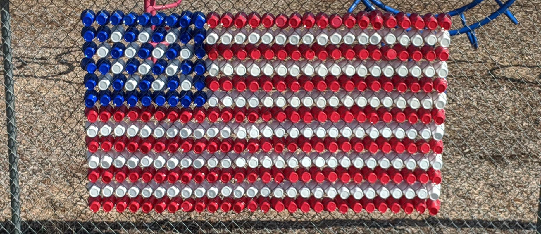 American Flag on the fence made out of dixie cups