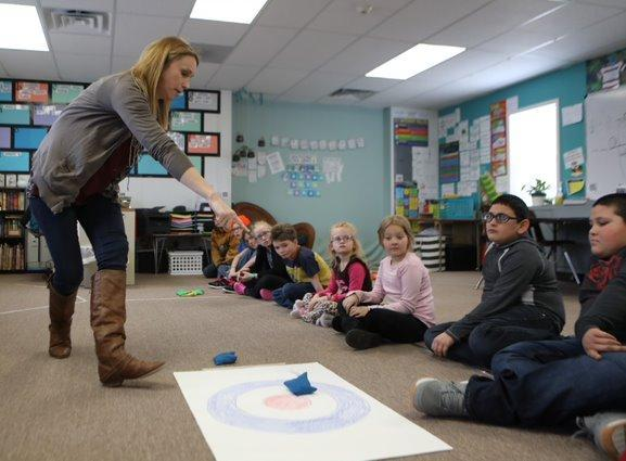 Teacher instructing students, Photo from Mike Moore / Douglas Budget